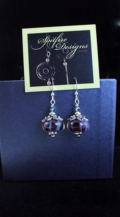 Enchanted Earrings | Spitfire Designs Handmade lampwork glass and Sterling Silver.  Gorgeous and gorgeous bead caps that top off the earring. #GlassEarrings #LampworkGlass #SpitfireDesignsJewelry