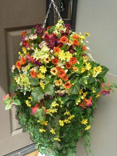 Hanging basket large with artificial yellow/orange daisies & fuchsias
