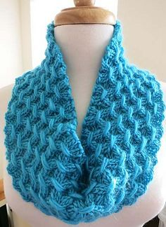 Beautiful texture in a rich shade of teal enhances the cozy look of this comfy cowl!