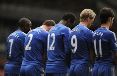 The Chelsea players defend a Tottenham free-kick as the home side look to threaten.