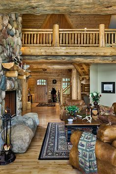 this is gorgeous for great room or living room. Beautiful railing for stairs. cabin log home living room