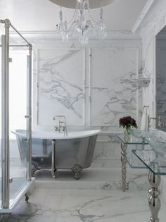 Bathroom - Stunning bath tub surrounded with marble walls & floor and lots of glass and sparkling surfaces.....Hollywood glam!