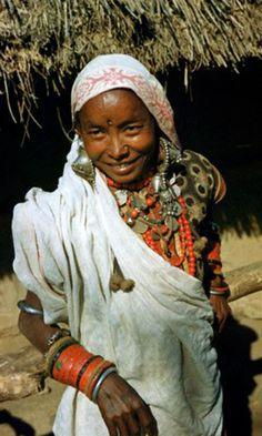 Nepal | 'Smiling Nepalese woman wears copious silver jewellery'.  ca. 1950 | ©Volkmar K. Wentzel