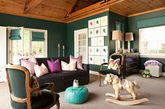 Green playroom with lavender and chevron pillows.  Brilliant Carter Kustera portraits bring together an amazing family collage!  #jfdesigns #jennfeldmandesigns