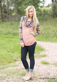 The Cowl Neck Aztec Sleeve Top is the perfect, cozy fall item to update your wardrobe! Pair with skinny jeans a great bootie.