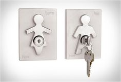 """HIS & HERS KEY HOLDERS    Are you always looking for your keys? Simply put the master key (included) into the lock and you will never lose them again! With a contemporary design and a chrome finish, the famous """"His & Hers Key Holders"""" look great and are an excellent gift idea."""