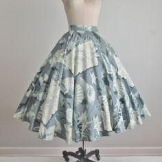 Gorgeous 50s skirt! Features include:  * Sateen cotton with a gorgeous novelty print * Sparkling prong-set rhinestones * Full 360 degree circle