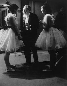 Two ballerinas receiving instruction from Monsieur Ruhlmann, France Paris by Brassai