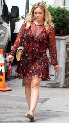 Revealing: The former Lizzie McGuire star's frock included a sheer plunging… The actress put her slender stems on display in a sheer red mini dress before slipping into cute black overalls on the New York City set of her comedy drama Younger on Thursday. Hilary Duff Legs, Hilary Duff Show, Hilary Duff Style, Top Celebrities, Celebs, Beautiful Celebrities, Haylie Duff, Lizzie Mcguire, Indian Beauty Saree