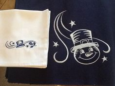 Christmas Placemats and Matching Napkins - I really like this snowman and the hat on the napkin but I don't want it on black... maybe red or white with black embroidery.