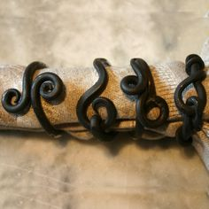 Wrought Iron Napkin Rings - $22.00 / set of four, but only like the design of the left one...