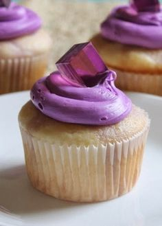 Grape Jello Shot Cupcakes Recipe ~ Boozy cupcakes, poked and loded with bozzy jello are topped with pretty purple frosting and bozzy jello cube on top.