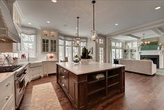 BEAUTIFUL, wonderful open kitchen area. Love the wide plank floors. Possibly my favorite kitchen ever.