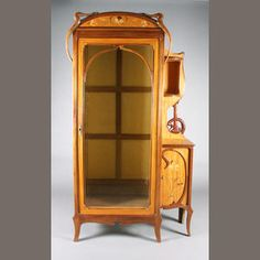 A French Art Nouveau mahogany, satinwood and floral marquetry inlaid cabinet and matching bedside cabinet in the Galle style