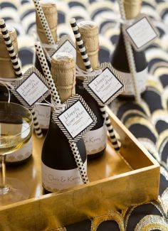 These pretty, petite champagne bottles make lovely wedding favors. We personalized an Avery Square Label (22806) and put it on a Chevron Tag, then made a complementary Wraparound Label (80506) for free at www.avery.com/print.