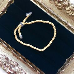 New & authentic David Yurman silk cord bracelet So pretty and delicate! Wear alone or combine with a stack of other bracelets. Yellow silk cord / cable and sterling silver. Stamped for authenticity. No bag or box (reflected in price), but I will mail in a soft jewelry bag (see pic #2). NWOT; never worn other than to take pic #4. David Yurman Jewelry Bracelets