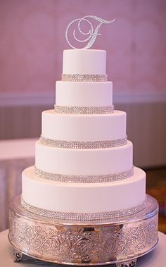 We love a traditional white wedding cake with just a touch of bling