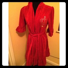 Juicy Couture Velour Royal Red Robe This is I would say vintage juicy ! It's a beautiful red with cute ruffled bottom sleeves , tie belt and a the blinged Juicy name in Gold ! It's from a vintage store that I bought years ago maybe wore it twice ! This is a must have for that beautiful flirty girl who likes to feel glam !! Size small(the last photo is just to show similarly what the robe looks like. The 3 top photos are my robe ) Juicy Couture Intimates & Sleepwear Robes