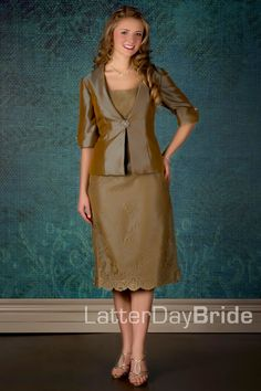 This modest Mother of the Bride dress is a strapless gown with jacket included. It features classic lace with a taffeta jacket and rhinestone clasp. this will be in the color of light green