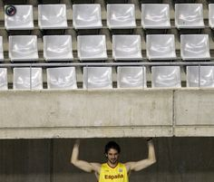 Pau Gasol stretches during a training session of the Spanish basketball team ahead of the London 2012 Olympic Games, at Palau Sant Jordi in Barcelona. GUSTAU NACARINO/REUTERS