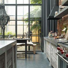 window detail + brickwork + beaded black chandelier + concrete counters via living etc