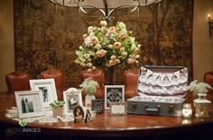 Rustic white frames, lace doilies,  baby's breath, lanterns, & vintage suit case for gifts at welcome table | villasiena.cc | Lasting Images Photography
