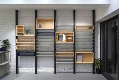 """The optical shop P.Y.E is located in Moscow on the the territory of the old foundry """"Manometr"""" (founded in 1886). The corner with milky coloured panels were inspired by interiors of idealised spaceships. Stone furniture is a tribute to the Moscow architec…"""