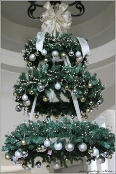 Hanging Christmas Tree - WREATH CHANDELIER ~ This would be so pretty in the entryway! this would make a very pretty outdoor tree for our porch Christmas Decor Diy Cheap, Hanging Christmas Tree, Noel Christmas, Christmas Projects, Winter Christmas, Christmas Wreaths, Holiday Decor, Hanging Christmas Decorations, Christmas Ornaments