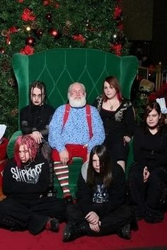 I'm goth, but I still want a picture with Santa. But you aren't going to make me smile!
