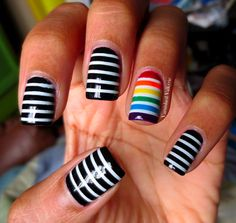 Black and white stripes with rainbow accent nail art design (striping tape technique)
