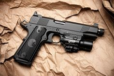 Pretty sure I need one of these too. Nighthawk 1911. Not exactly sure, but I am guessing its the Tactical As Fuck model. Note the raised sights for suppressor clearance!