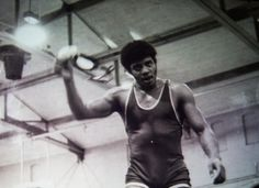 Cosmos host and astrophysicist Neil DeGrasse Tyson at a college wrestling match.