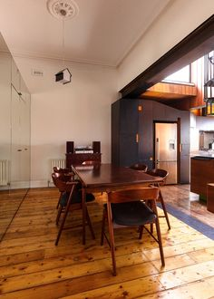 Traditional wooden floors are used to link the old and new parts of the house together. - House House