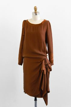 Brown silk dress, ca. 1920s. I feel like this could be worn now. Shorten the sleeves change the color.