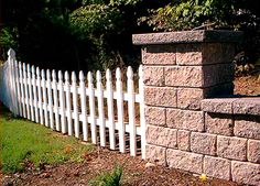 Masonry fences and picket fences can be joined, as this image illustrates. The latter does, however, lose some of its hominess in the union.