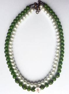 Handmade necklace created with white and green pearls.    www.facebook.com/SimplicitybyMelanie