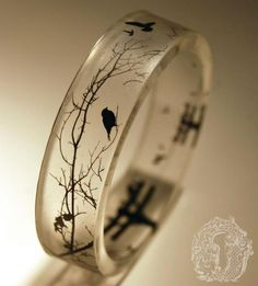 Resin birdy bangle from Omnia Studios. There's similar ones with cityscapes, bats, deer, and some really cool colourful ones with cherry blossoms, dandelion seed tufts, pacman, glow in the dark stars...