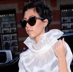 That top is so future with those cat-eyes / Kourtney Kardashian, 2010