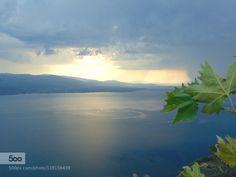 Blue lake by setee  beautiful blue clouds greece lake nature photograph summer sunset travel tree water trichonida lake