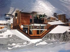 The rear of the Chalet with mountains in the background