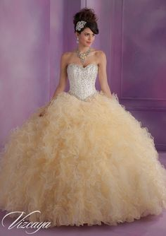 Look and feel like a Queen in gorgeous this Ivory and Gold Ruffled gown! The sweetheart bodice is full of crystals which match the completely beaded waistline. Use the vest to spice up your look with