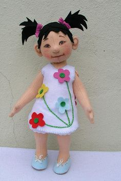 100% wool felt doll, handmade, ooak.Clothes and hair are also made out of felt. So inspiring .