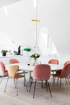 Modern loft dining room with pink velvet chairs and LED light fixture on Thou Swell @thouswellblog