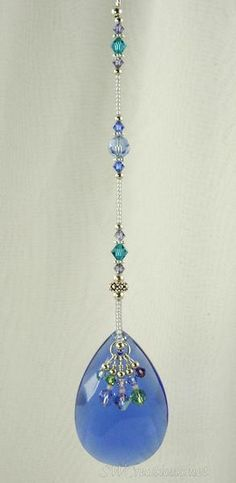 Handcrafted silver 8 inch beaded fan pull with a 6 inch bar ball chain, blue matte silver-lined seed beads, blue zircon, tanzanite, amethyst, peridot, and light