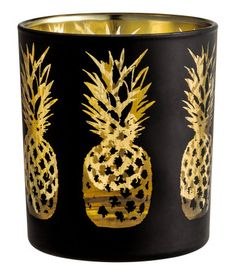 Black/pineapple. Glass tea light holder with a shimmering metallic pattern. Height 3 1/4 in., diameter 2 3/4 in.