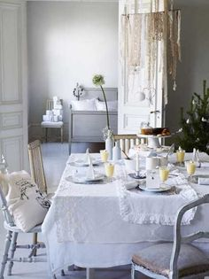 Gorgeous white dining room table set for the holidays or Christmas dinner. All of course in glorious shades and textures of white!
