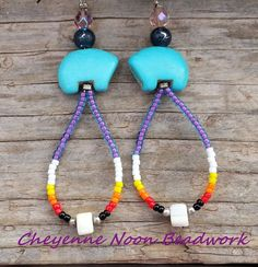 These earrings are made with magnesite gemstone Zuni bears topped with a rainbow amethyst Czech fire-polished faceted glass bead and a black and