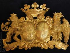 a picture of the gilded German alliance coat of arms, now with an old patina and aging look. A great result.