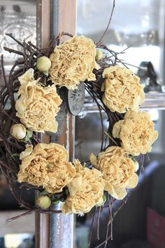 summer white peonies are dried then added to a natural wreath