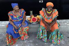 'Palenqueras' sell fruit and candy to cruise ship passengers who disembark in Cartagena, Colombia.